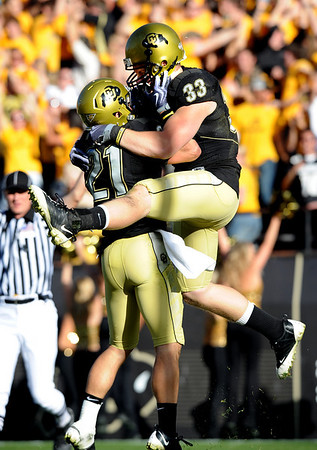 "Patrick Devenny (33) of Colorado, jumps in the arms of Scotty McKnight after catching the game winning touchdown to beat Texas A & M 35-34 on Saturday.<br /> <br /> For more photos from the game, go to  <a href=""http://www.dailycamera.com"">http://www.dailycamera.com</a>.<br /> Cliff Grassmick / November 7, 2009"