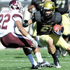 University of Colorado's Scotty McKnight, (21) drives the ball forward as Texas A&M's Dustin Harris defends during the game at Folsom Field on the University of Colorado campus in Boulder, Saturday, Nov. 7,  2009. <br /> KASIA BROUSSALIAN / THE CAMERA