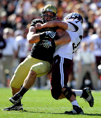 """Riar Geer of CU muscles his way for a first down against the Aggies.<br /> For more photos from the game, go to  <a href=""""http://www.dailycamera.com"""">http://www.dailycamera.com</a>.<br /> Cliff Grassmick / November 7, 2009"""
