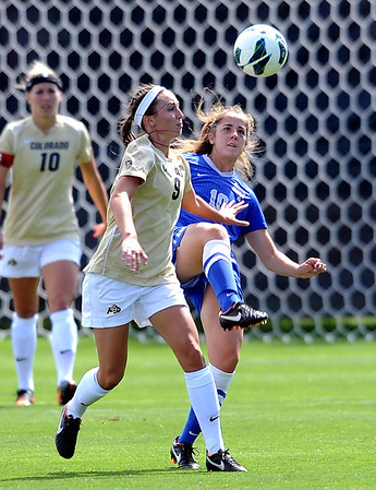 "McKenna Fox, right, of Air Force, kicks the ball away from Darcy Jerman of CU.<br /> For more photos of the game, go to  <a href=""http://www.dailycamera.com"">http://www.dailycamera.com</a>.<br /> Cliff Grassmick  / September 16, 2012"