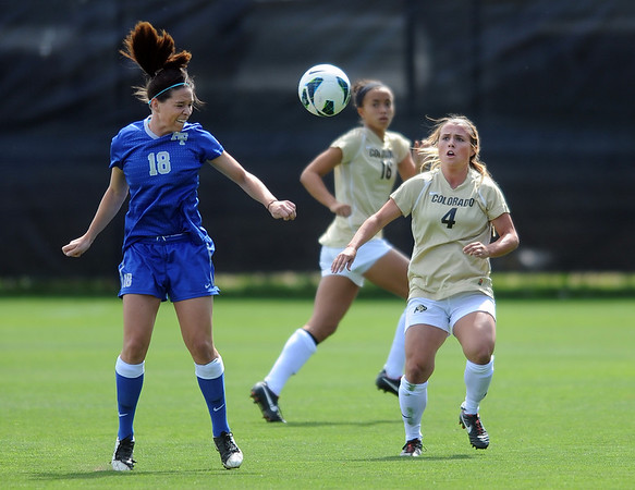 "Stephanie Patterson, left, of Air Force, and Madison Krauser of CU, look to control the ball.<br /> For more photos of the game, go to  <a href=""http://www.dailycamera.com"">http://www.dailycamera.com</a>.<br /> Cliff Grassmick  / September 16, 2012"