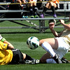 "Hayley Hughes, right, of CU, charges the goal but is stopped by Air Force keeper, Kelly Stambaugh.<br /> For more photos of the game, go to  <a href=""http://www.dailycamera.com"">http://www.dailycamera.com</a>.<br /> Cliff Grassmick  / September 16, 2012"