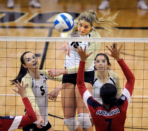 """Nikki Lindow of CU, hits a rocket past Olivia Magill of Arizona.<br /> For more photos of the game, go to  <a href=""""http://www.dailycamera.com"""">http://www.dailycamera.com</a>.<br /> Cliff Grassmick / October 14, 2012"""