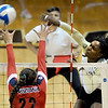 "Alexis Austin of CU, hits past Shaquillah Torres of Arizona on Sunday.<br /> For more photos of the game, go to  <a href=""http://www.dailycamera.com"">http://www.dailycamera.com</a>.<br /> Cliff Grassmick / October 14, 2012"