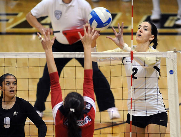 """Ana Pantovic pushes one over the Arizona defender.<br /> For more photos of the game, go to  <a href=""""http://www.dailycamera.com"""">http://www.dailycamera.com</a>.<br /> Cliff Grassmick / October 14, 2012"""
