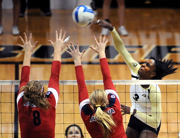 """Alexis Austin of CU, hits over Rachel Rhoades and another defender from Arizona on Sunday.<br /> For more photos of the game, go to  <a href=""""http://www.dailycamera.com"""">http://www.dailycamera.com</a>.<br /> Cliff Grassmick / October 14, 2012"""