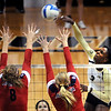 "Alexis Austin of CU, hits over Rachel Rhoades and another defender from Arizona on Sunday.<br /> For more photos of the game, go to  <a href=""http://www.dailycamera.com"">http://www.dailycamera.com</a>.<br /> Cliff Grassmick / October 14, 2012"