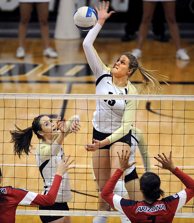 "Nikki Lindow of CU goes high to hit over Arizona on Sunday.<br /> For more photos of the game, go to  <a href=""http://www.dailycamera.com"">http://www.dailycamera.com</a>.<br /> Cliff Grassmick / October 14, 2012"