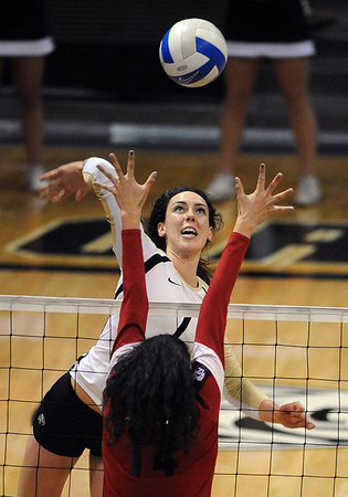 "Kelsey English of CU hits past Taylor Arizbal of Arizona on Sunday.<br /> For more photos of the game, go to  <a href=""http://www.dailycamera.com"">http://www.dailycamera.com</a>.<br /> Cliff Grassmick / October 14, 2012"