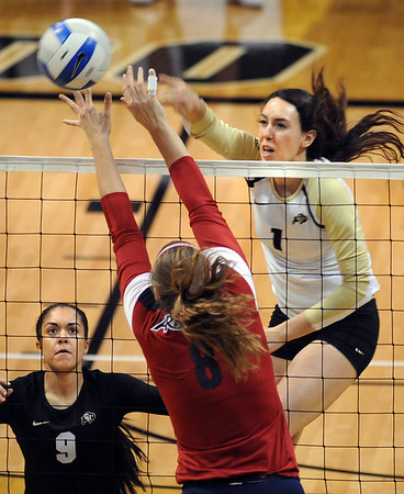 "Kelsey English of CU hits past Rachel Rhoades of Arizona on Sunday.<br /> For more photos of the game, go to  <a href=""http://www.dailycamera.com"">http://www.dailycamera.com</a>.<br /> Cliff Grassmick / October 14, 2012"