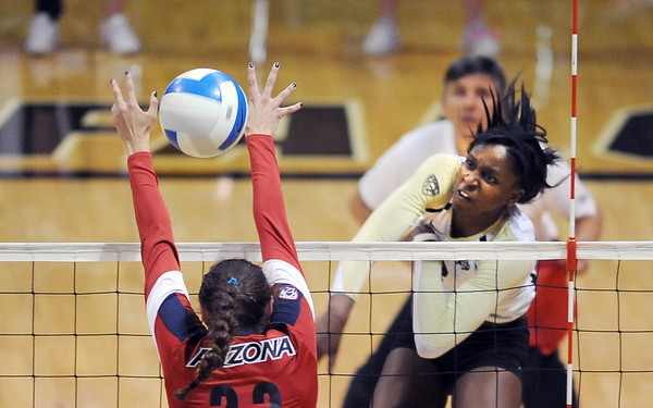 """Alexis Austin of CU, hits past Shaquillah Torres of Arizona on Sunday.<br /> For more photos of the game, go to  <a href=""""http://www.dailycamera.com"""">http://www.dailycamera.com</a>.<br /> Cliff Grassmick / October 14, 2012"""