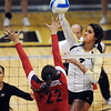 "Neira Ortiz Ruiz of CU, hits past Shaquillah Torres of Arizona on Sunday.<br /> For more photos of the game, go to  <a href=""http://www.dailycamera.com"">http://www.dailycamera.com</a>.<br /> Cliff Grassmick / October 14, 2012"