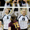 "University of Colorado's Nicole Edelman, left, and Nikki Lindow try to block a kill from Macey Gardner during a volleyball match against Arizona State on Friday, Oct. 12, at the Coors Event Center on the CU campus in Boulder. For more photos of the match go to  <a href=""http://www.dailycamera.com"">http://www.dailycamera.com</a><br /> Jeremy Papasso/ Camera"
