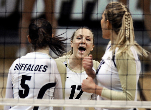 "University of Colorado's Michelle Miller, center celebrates a point with Nicole Edelman, left, and Nikki Lindow during a volleyball match against Arizona State on Friday, Oct. 12, at the Coors Event Center on the CU campus in Boulder. For more photos of the match go to  <a href=""http://www.dailycamera.com"">http://www.dailycamera.com</a><br /> Jeremy Papasso/ Camera"
