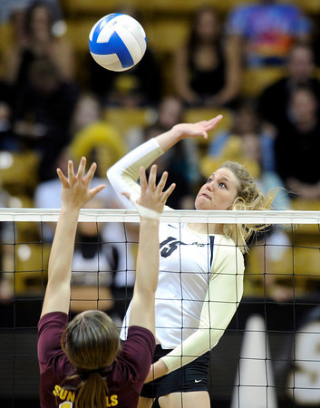 "University of Colorado's Nikki Lindow goes for a kill over Macey Gardner during a volleyball match against Arizona State on Friday, Oct. 12, at the Coors Event Center on the CU campus in Boulder. For more photos of the match go to  <a href=""http://www.dailycamera.com"">http://www.dailycamera.com</a><br /> Jeremy Papasso/ Camera"