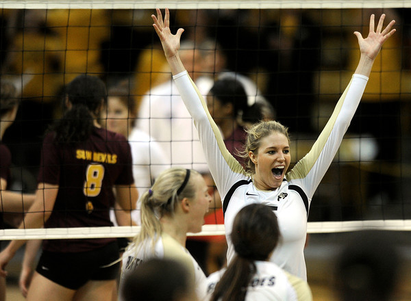 "University of Colorado's Nikki Lindow celebrates with her teammates after beating Arizona State during a volleyball match on Friday, Oct. 12, at the Coors Event Center on the CU campus in Boulder. For more photos of the match go to  <a href=""http://www.dailycamera.com"">http://www.dailycamera.com</a><br /> Jeremy Papasso/ Camera"