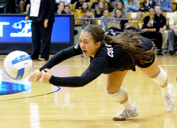 """University of Colorado's Chelsey Keoho dives to save a ball during a volleyball match against Arizona State on Friday, Oct. 12, at the Coors Event Center on the CU campus in Boulder. For more photos of the match go to  <a href=""""http://www.dailycamera.com"""">http://www.dailycamera.com</a><br /> Jeremy Papasso/ Camera"""