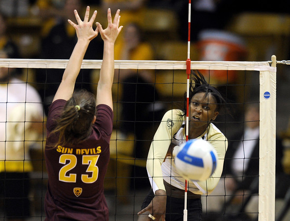"University of Colorado's Alexis Austin watches the ball drop for a point after a kill over Allison Palmer during a volleyball match against Arizona State on Friday, Oct. 12, at the Coors Event Center on the CU campus in Boulder. For more photos of the match go to  <a href=""http://www.dailycamera.com"">http://www.dailycamera.com</a><br /> Jeremy Papasso/ Camera"
