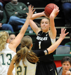 Lexy Kresl of CU looks to pass on CSU. For more photos of CU and CSU, go to www.dailycamera.com. November 20, 2011 / Cliff Grassmick