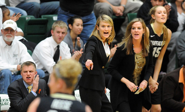 "Head CU coach, Linda Lappe, center, coaches her players during the CSU game on Sunday.<br /> For more photos of CU and CSU, go to  <a href=""http://www.dailycamera.com"">http://www.dailycamera.com</a>.<br /> November 20, 2011 / Cliff Grassmick"