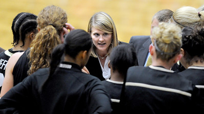 Linda Lappe talks to her players during the CSU game on Sunday. For more photos of CU and CSU, go to www.dailycamera.com. November 20, 2011 / Cliff Grassmick