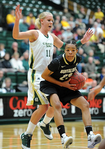 Chucky Jeffery, of CU, gets the shot under Meghan Heimstra  of Colorado State on Sunday. For more photos of CU and CSU, go to www.dailycamera.com. November 20, 2011 / Cliff Grassmick