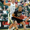 "Chucky Jeffery, of CU, gets the shot under Meghan Heimstra  of Colorado State on Sunday.<br /> For more photos of CU and CSU, go to  <a href=""http://www.dailycamera.com"">http://www.dailycamera.com</a>.<br /> November 20, 2011 / Cliff Grassmick"
