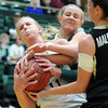 """Meghan Heimstra, left, of CSU, and Julie Seabrook of CU, get tied up.<br /> For more photos of CU and CSU, go to  <a href=""""http://www.dailycamera.com"""">http://www.dailycamera.com</a>.<br /> November 20, 2011 / Cliff Grassmick"""