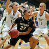 "Chucky Jeffery, center, of CU gets the pass around Kelly Hartig, left, and Maghan Heimstra, of Colorado State on Sunday.<br /> For more photos of CU and CSU, go to  <a href=""http://www.dailycamera.com"">http://www.dailycamera.com</a>.<br /> November 20, 2011 / Cliff Grassmick"