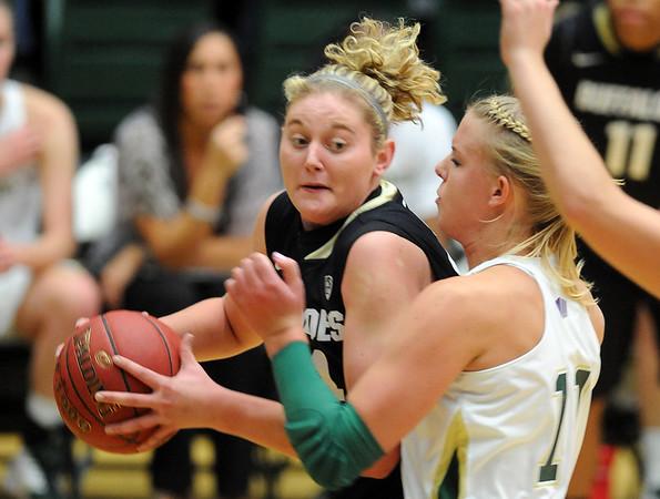 "Jen Reese of CU looks to shoot against Meghan Heimstra of CSU.<br /> For more photos of CU and CSU, go to  <a href=""http://www.dailycamera.com"">http://www.dailycamera.com</a>.<br /> November 20, 2011 / Cliff Grassmick"