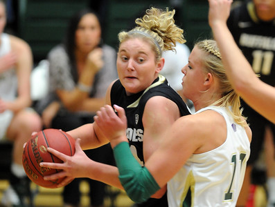 Jen Reese of CU looks to shoot against Meghan Heimstra of CSU. For more photos of CU and CSU, go to www.dailycamera.com. November 20, 2011 / Cliff Grassmick