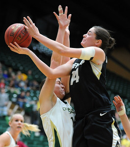 Meagan Malcolm-Peck of CU, gets a shot over Sam Martin of CSU. For more photos of CU and CSU, go to www.dailycamera.com. November 20, 2011 / Cliff Grassmick