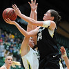 "Meagan Malcolm-Peck of CU, gets a shot over Sam Martin of CSU.<br /> For more photos of CU and CSU, go to  <a href=""http://www.dailycamera.com"">http://www.dailycamera.com</a>.<br /> November 20, 2011 / Cliff Grassmick"