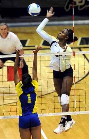 """Alexis Austin of CU hits past Fernanda Goncalves of CSU-Bakersfield on Saturday.<br /> For more photos of the game, go to  <a href=""""http://www.dailycamera.com"""">http://www.dailycamera.com</a><br /> Cliff Grassmick / September 15, 2012"""