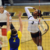"""Alexis Austin of CU hits past Kelsee Sawyer of CSU-Bakersfield on Saturday.<br /> For more photos of the game, go to  <a href=""""http://www.dailycamera.com"""">http://www.dailycamera.com</a><br /> Cliff Grassmick / September 15, 2012"""
