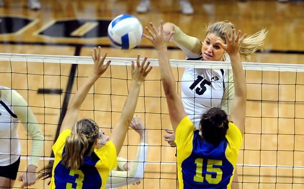 "Nikki Lindow of CU prepares to hit past Shayne Guitare (3) and  Molly O'Hagan  of CSU-Bakersfield on Saturday.<br /> For more photos of the game, go to  <a href=""http://www.dailycamera.com"">http://www.dailycamera.com</a><br /> Cliff Grassmick / September 15, 2012"