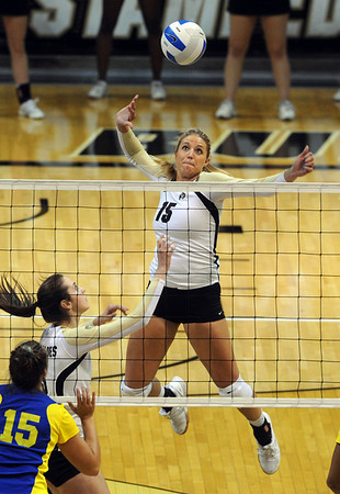 """Nikki Lindow of CU prepares to hit past Molly O'Hagan  of CSU-Bakersfield on Saturday.<br /> For more photos of the game, go to  <a href=""""http://www.dailycamera.com"""">http://www.dailycamera.com</a><br /> Cliff Grassmick / September 15, 2012"""