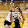"""Kelsey English of CU prepares to hit on Sara Aloisio of CSU-Bakersfield.<br /> For more photos of the game, go to  <a href=""""http://www.dailycamera.com"""">http://www.dailycamera.com</a><br /> Cliff Grassmick / September 15, 2012"""