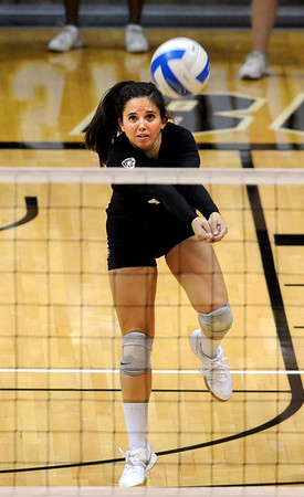 """Elysse Richardson of CU, digs one out against CSU-Bakersfield.<br /> For more photos of the game, go to  <a href=""""http://www.dailycamera.com"""">http://www.dailycamera.com</a><br /> Cliff Grassmick / September 15, 2012"""