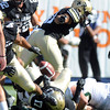 "Marques Mosley of CU looses the ball after hitting the ground on a kick return during the second half of the Rocky Mountain Showdown at Sports Authority Field in Denver on September 1, 2012.<br /> For more photos of the game, go to  <a href=""http://www.dailycamera.com"">http://www.dailycamera.com</a>.<br /> Cliff Grassmick / September 1, 2012"