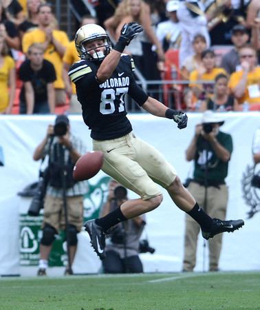 """University of Colorado's Tyler McCulloch drops a pass during the Rocky Mountain Showdown against Colorado State University on Saturday, Sept. 1, at Sports Authority Field at Mile High in Denver. For more photos of the game go to  <a href=""""http://www.dailycamera.com"""">http://www.dailycamera.com</a><br /> Jeremy Papasso/ Camera"""