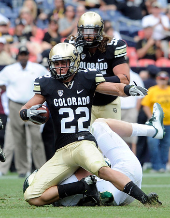 """University of Colorado's Nelson Spruce is tackled after making a catch during the Rocky Mountain Showdown against Colorado State University on Saturday, Sept. 1, at Sports Authority Field at Mile High in Denver. For more photos of the game go to  <a href=""""http://www.dailycamera.com"""">http://www.dailycamera.com</a><br /> Jeremy Papasso/ Camera"""