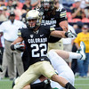 "University of Colorado's Nelson Spruce is tackled after making a catch during the Rocky Mountain Showdown against Colorado State University on Saturday, Sept. 1, at Sports Authority Field at Mile High in Denver. For more photos of the game go to  <a href=""http://www.dailycamera.com"">http://www.dailycamera.com</a><br /> Jeremy Papasso/ Camera"
