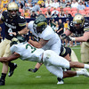 University of Colorado quarterback Jordan Webb, left, is sacked by Colorado State defenders Cory James, bottom, and Alex Tucci in the first quarter of their game Saturday, Sept. 1, 2012 at Sports Authority Field at Mile High. (Steve Stoner/Loveland Reporter-Herald)
