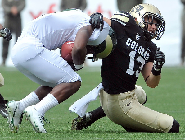 """University of Colorado's Parker Orms makes a tackle on Charles Lovett during the Rocky Mountain Showdown against Colorado State University on Saturday, Sept. 1, at Sports Authority Field at Mile High in Denver. For more photos of the game go to  <a href=""""http://www.dailycamera.com"""">http://www.dailycamera.com</a><br /> Jeremy Papasso/ Camera"""