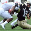 "University of Colorado's Parker Orms makes a tackle on Charles Lovett during the Rocky Mountain Showdown against Colorado State University on Saturday, Sept. 1, at Sports Authority Field at Mile High in Denver. For more photos of the game go to  <a href=""http://www.dailycamera.com"">http://www.dailycamera.com</a><br /> Jeremy Papasso/ Camera"