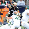 """CU QB Jordan Webb gets rid of the ball before he is sacked by Aaron Davis and Max Morgan of CSU during the second half of the Rocky Mountain Showdown at Sports Authority Field in Denver on September 1, 2012.<br /> For more photos of the game, go to  <a href=""""http://www.dailycamera.com"""">http://www.dailycamera.com</a>.<br /> Cliff Grassmick / September 1, 2012"""