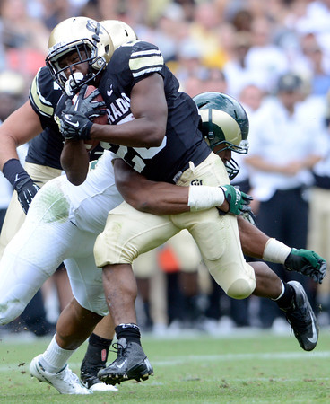 """University of Colorado's Tony Jones avoids a tackle by Cory James during the Rocky Mountain Showdown against Colorado State University on Saturday, Sept. 1, at Sports Authority Field at Mile High in Denver. For more photos of the game go to  <a href=""""http://www.dailycamera.com"""">http://www.dailycamera.com</a><br /> Jeremy Papasso/ Camera"""