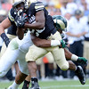 "University of Colorado's Tony Jones avoids a tackle by Cory James during the Rocky Mountain Showdown against Colorado State University on Saturday, Sept. 1, at Sports Authority Field at Mile High in Denver. For more photos of the game go to  <a href=""http://www.dailycamera.com"">http://www.dailycamera.com</a><br /> Jeremy Papasso/ Camera"