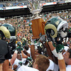 "The Colorado State Rams celebrate with the Centennial Cup after beating CU 22-17 at the Rocky Mountain Showdown at Sports Authority Field in Denver on September 1, 2012.<br /> For more photos of the game, go to  <a href=""http://www.dailycamera.com"">http://www.dailycamera.com</a>.<br /> Cliff Grassmick / September 1, 2012"